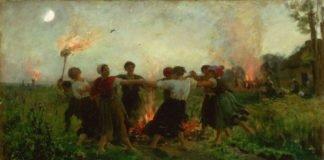 Mennesker som danser rundt et bål på st. hans aften